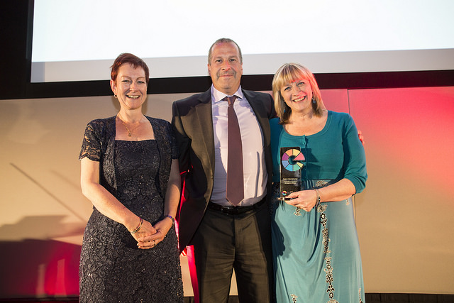 Stephanie Readey (right) and Professor Dominic Elliott from the Management School receive their award