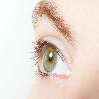 Human, green healthy eye macro with white background
