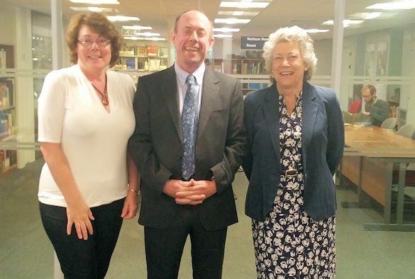Phil Sykes with Mrs Penny Gluckstein and Amanda Graves in the Library Special Collections and Archives