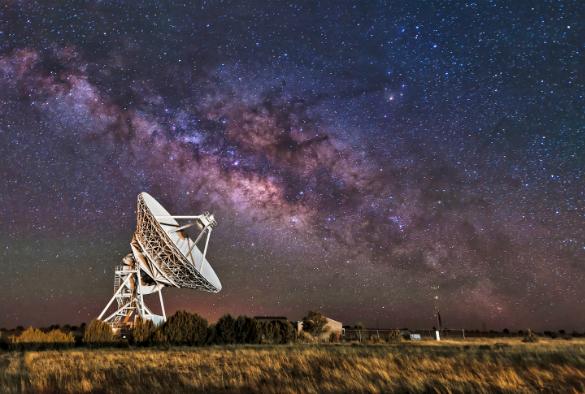 A radio telescope at night