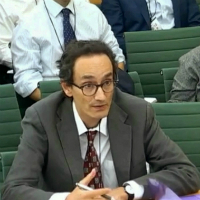 Professor Tom Solomon giving evidence at the government committee