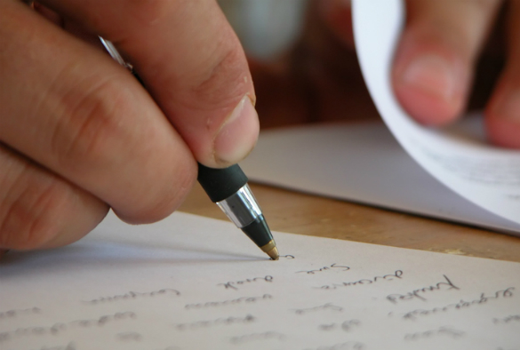 Close up of a person taking notes