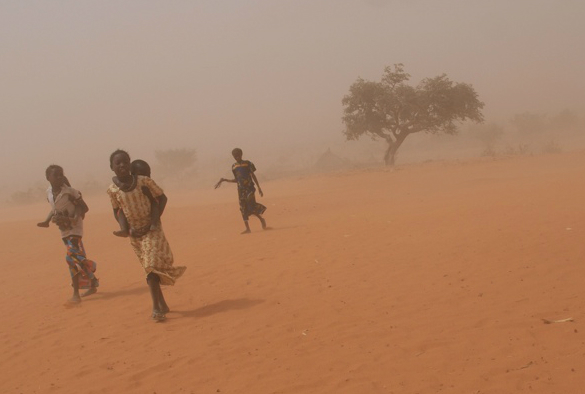 People walking through a sandstorm in Niger