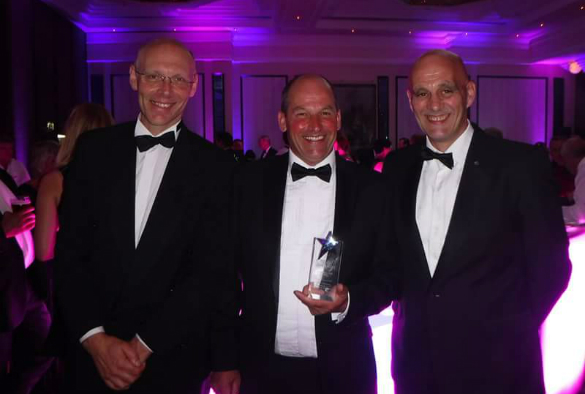 Professor Robert Smith, John Cameron and Andrew Parkinson with their award