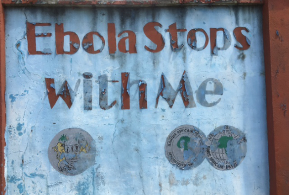A faded Ebola warning sign in Freetown, Sierra Leone