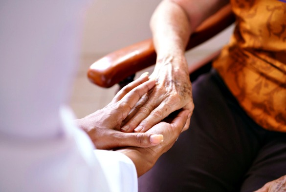 Doctor visiting elderly patient