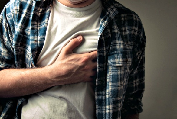 Man clutching heart