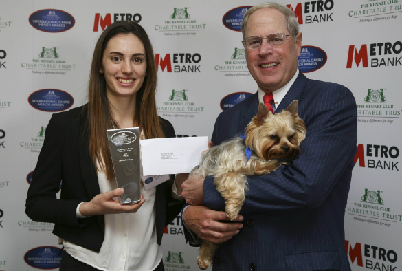 Undergraduate Student Inspiration Award Winner Harriet Davenport at the International Canine Health Awards 2017 with Vernon Hill and Sir Duffield the dog [credit: The Kennel Club]