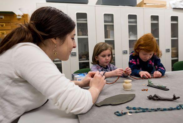 Visitors examine Museum artifacts
