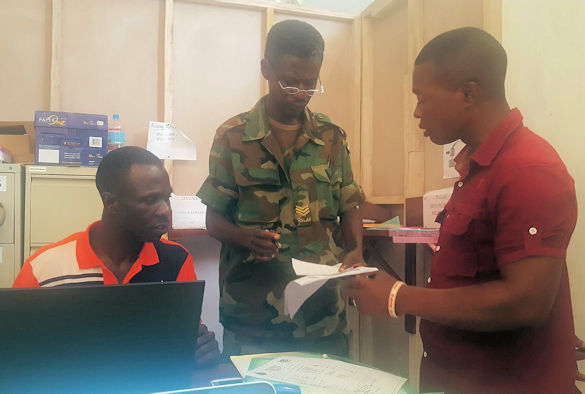 Image 2 - The study team verify data in the research room at Military Hospital 34, Freetown, Sierra Leone. From Right to Left, Serg Alimamy Kabia, Mr. Thomas Korfeh, Serg Caesar Mansaray (1)