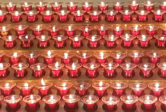 lit memorial candles