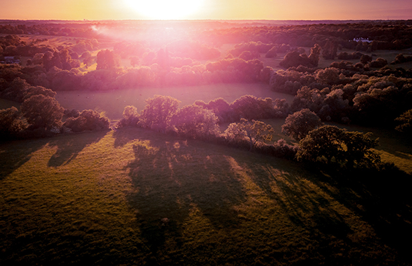 Aerial view of the countryside around London taken at sun set.