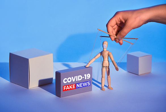 Covid19 novel coronavirus rumors. Sinister hand control wooden puppet on abstract geometric background. Box with text 'COVID-19 fake news'. Beware of fake news about outbreak 2019-nCoV treatments!