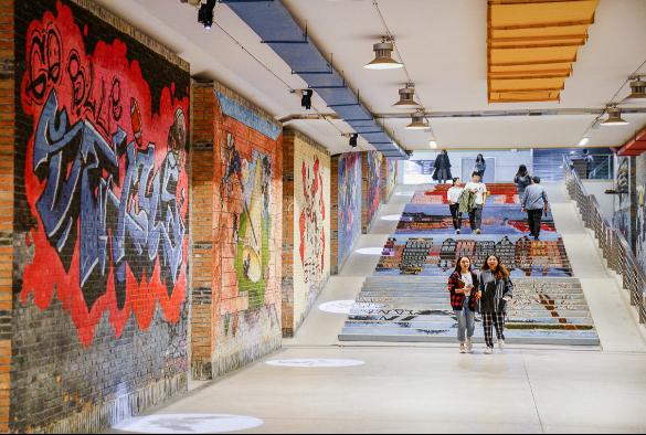 Students walking through a tunnel at XJTLU