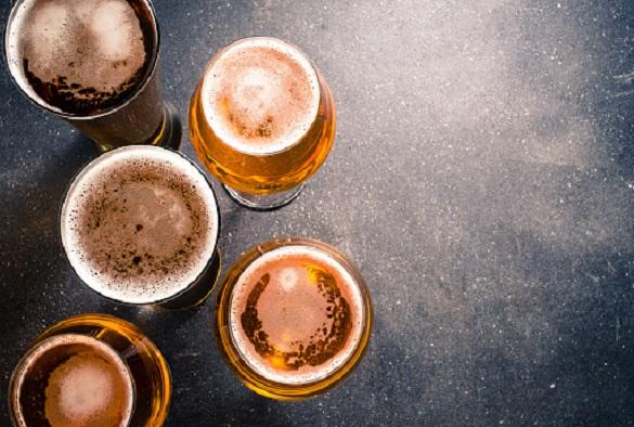 Beer glasses on dark background